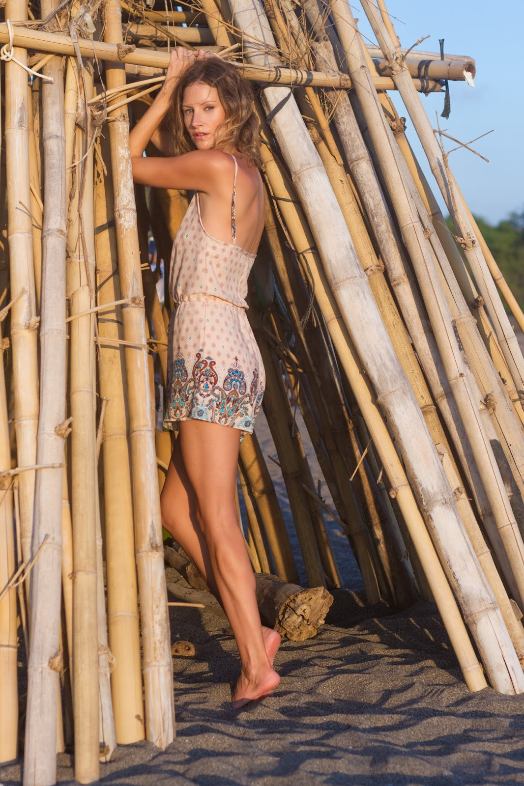 fashion blogger and designer, Alison Hutchinson, is wearing a KAYVALYA Ruko Romper in Bali, Indonesia