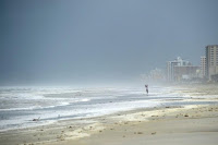 A beachgoer photographs the waves as a band of Hurricane Matthew arrives in Daytona Beach, Florida, U.S. October 6, 2016. (Credit: Reuters/Phelan Ebenhack) Click to Enlarge.