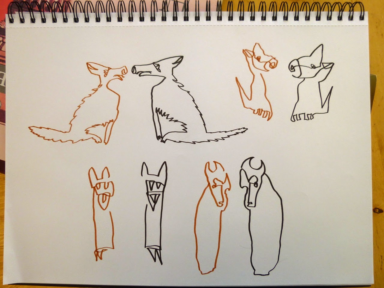 Animals drawn side-by-side simultaneously with left and right hand