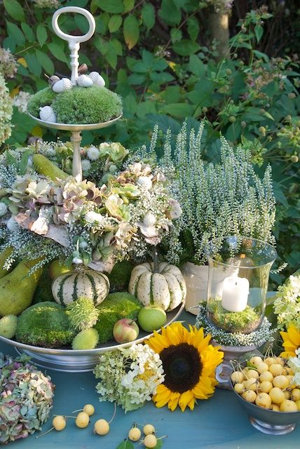 The greenery, mini pumpkins and fresh flowers make this table beautiful.