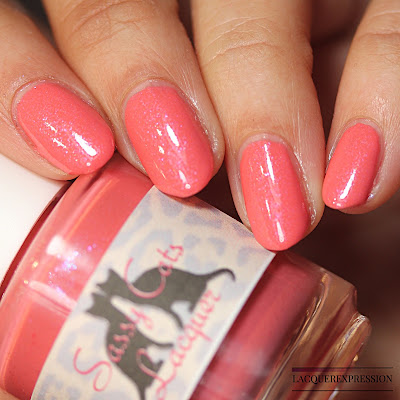 Swatches of a pink coral nail polish with blue microflakies by Sassy Cats Lacquer for the Le Petite Indies Spring It On! collaboration box