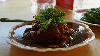 Yunnanese delight. Delicious serving of pork knuckles, stir fried vegetables and refreshing oolong tea for lunch