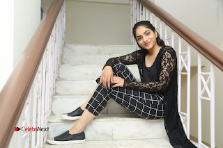 Actress Punarnavi Bhupalam Stills in Black Dress at Pittagoda Press Meet  0186.JPG