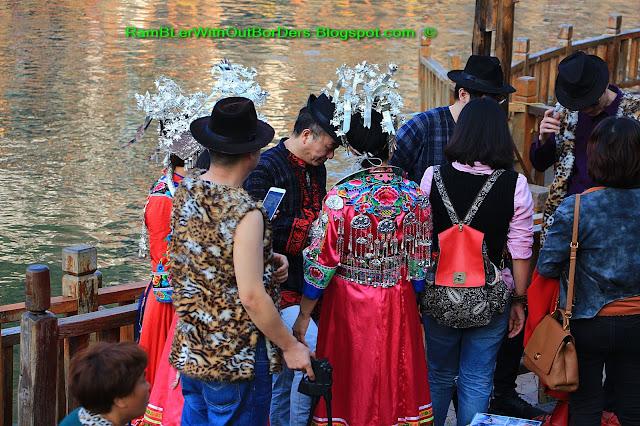 Tourists in ethnic costume, Riverside, Phoenix Fenghuang County, Hunan, China