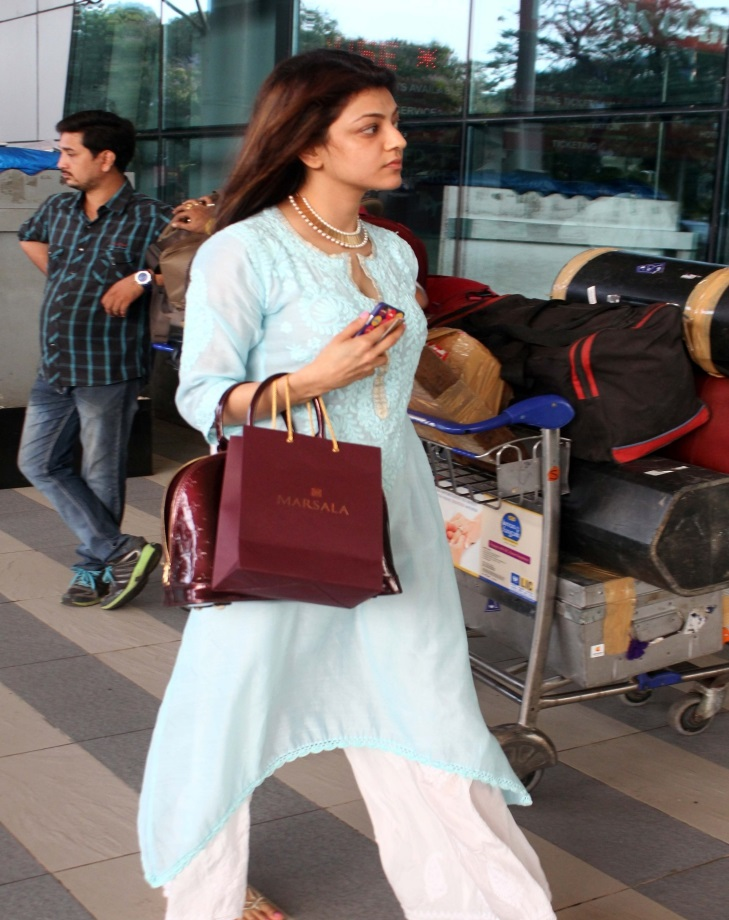 Kajal Agarwal At Airport Without MakeUp Face Stills In Blue Dress