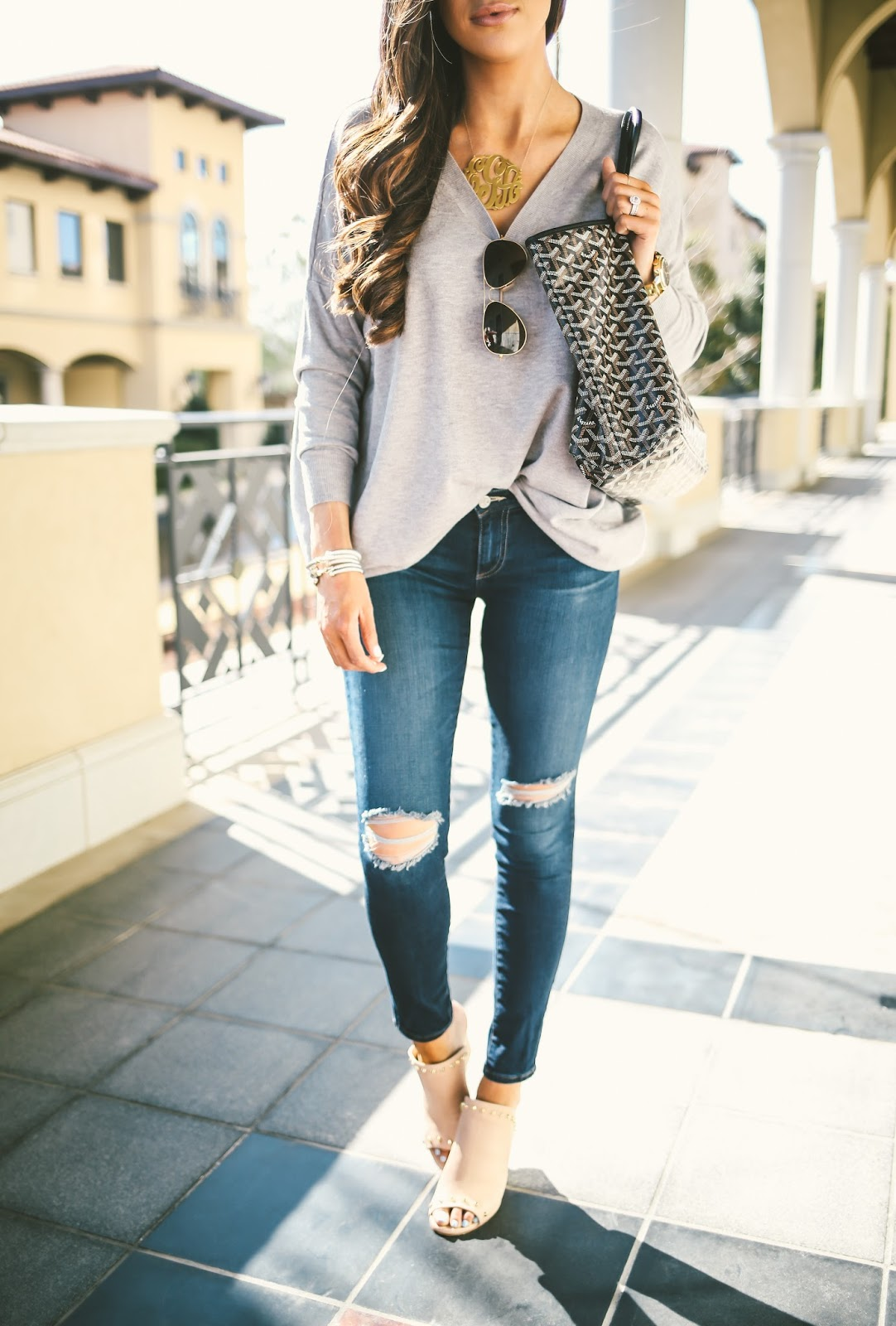 goyard PM handbag, black goyard bag, oversized gold monogram necklace, love always monogram necklace, AG jeans ripped knees, AG jeans ankle length skinny, Dreamer grey sweater, easy outfit idea, cute outfit ideas pinterest, easy to put together outfit ideas,  stuart weitzman upfrontal wedge, brunette balayage, brunette medium haircut, brunette long layers haircut, pinterest spring outfit ideas, pinterest cutest outfit ideas, emily gemma, the sweetest thing blog, tulsa fashion blog, michael kors watch with black face, david yurman bracelets stack, pinterest sweater jeans and wedges outfit