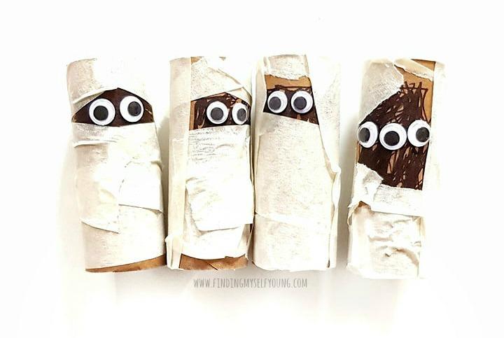 Four cardboard tube and tape mummies