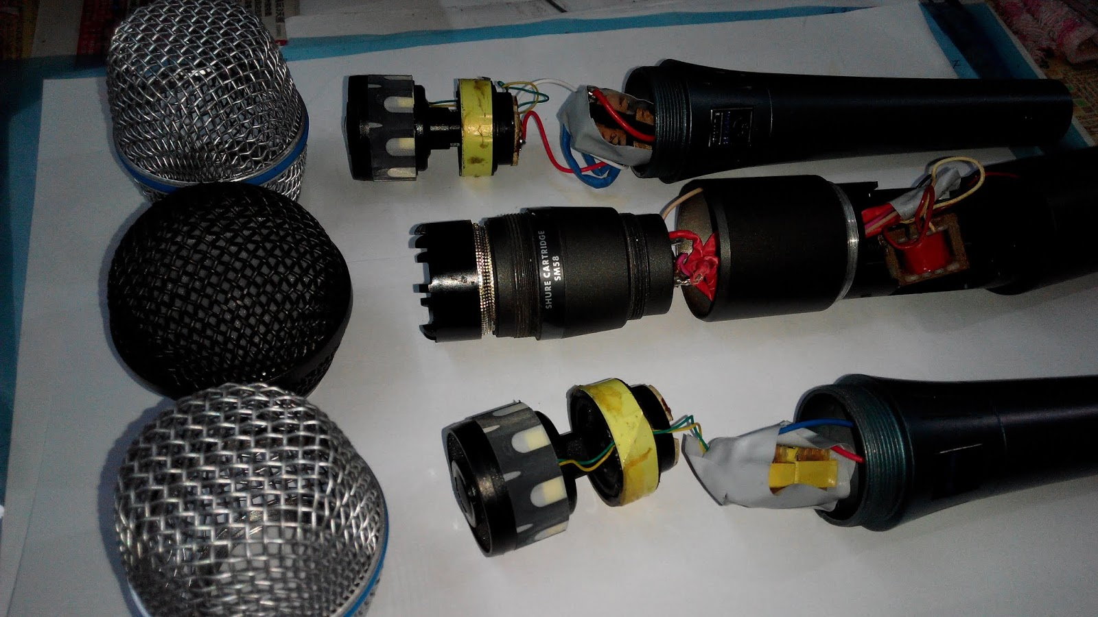 hight resolution of real shure mic capsule direct resistance is not more than 30 ohm but the china made shure mic is not less than 400 ohm anyway i use the suitable