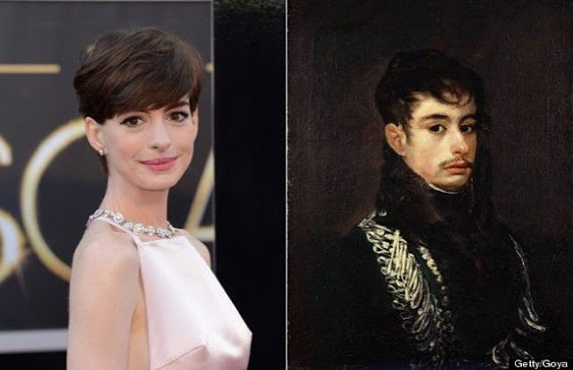 "Anne Hathaway and a portrait of ""Officer"" by Francisco Goya"