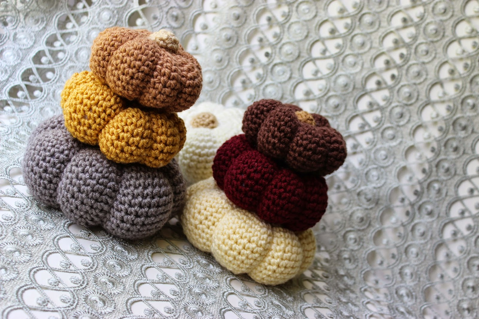 Crochet these sweet little pumpkins in modern colors. Stack them together or just a scattered little pile is always fun.