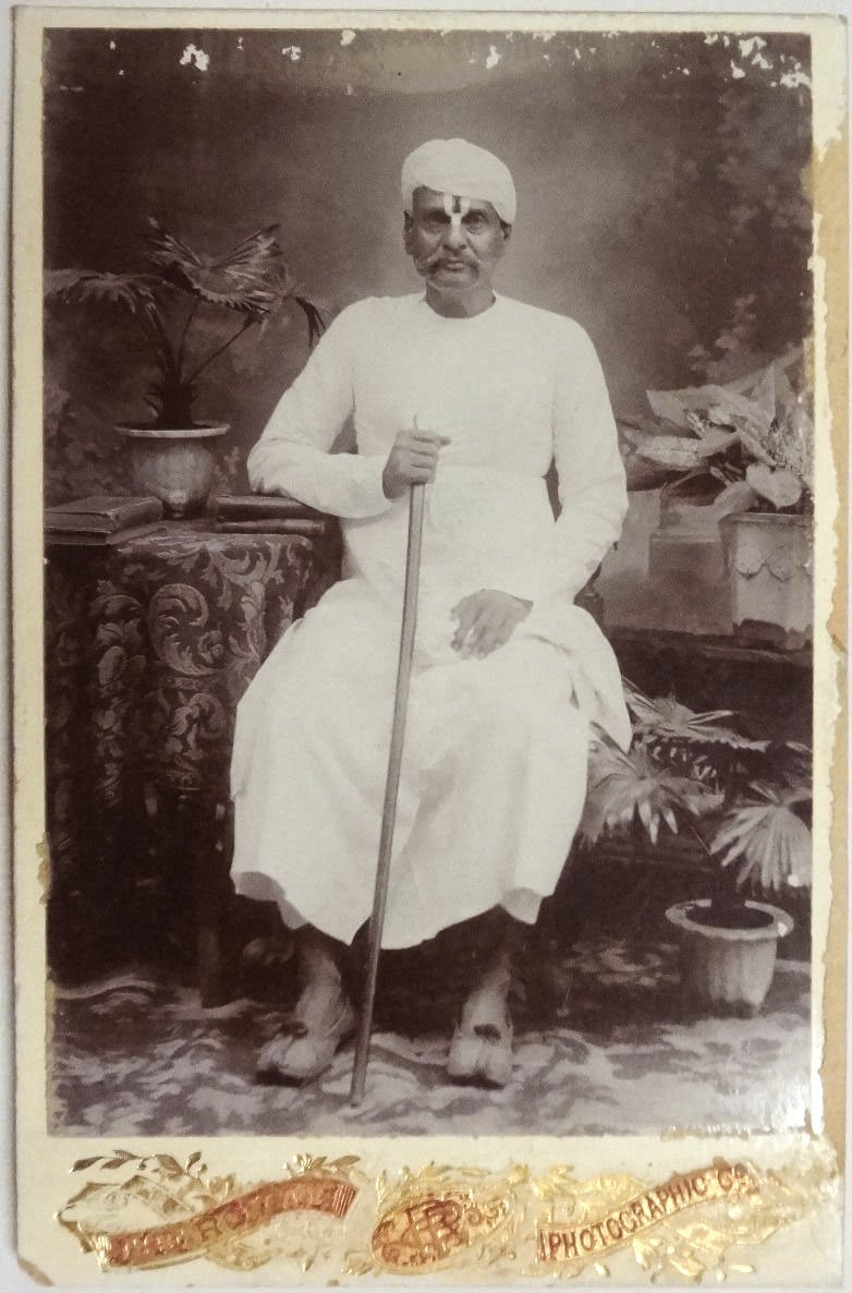 Studio Photograph of an Indian Man with a Stick