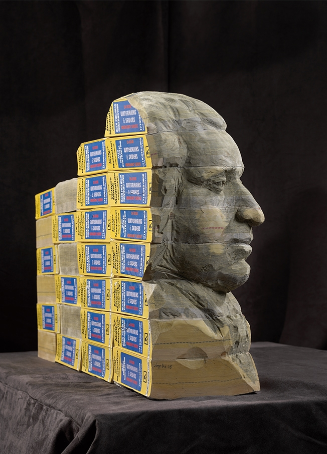 24-Mount-Rushmore-Long-Bin-Chen-A-Second-Life-for-Recycled-Book-Sculpting-www-designstack-co