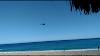 Un helicóptero y un avión  super tucano sobre vuelan la  playa  San Rafael de Barahona