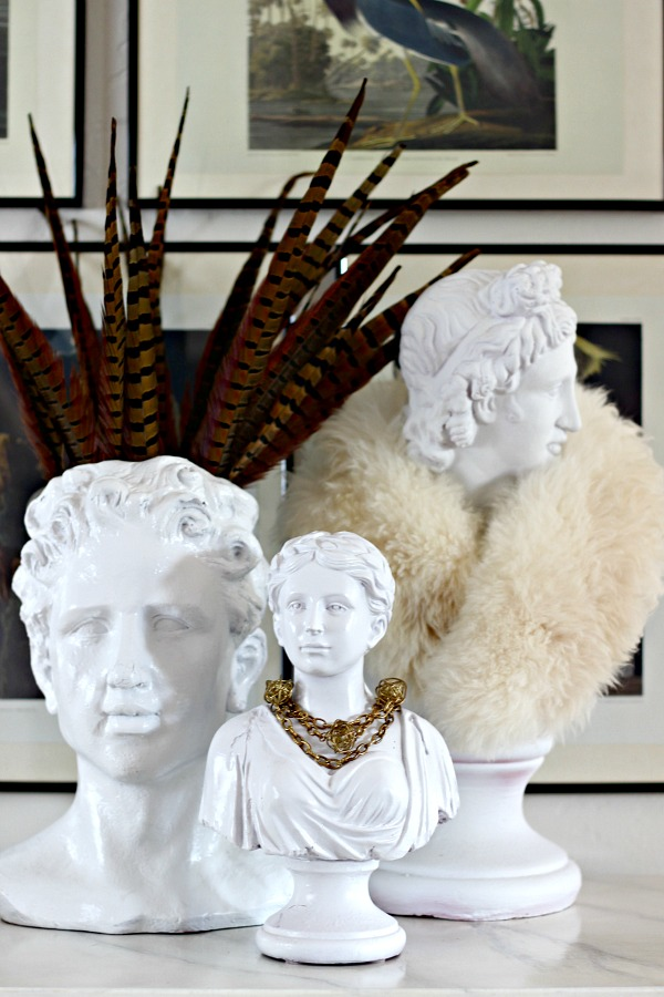plaster busts, head planter, pheasant feathers