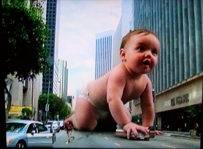 Photoshopped giant baby crawling down a city street
