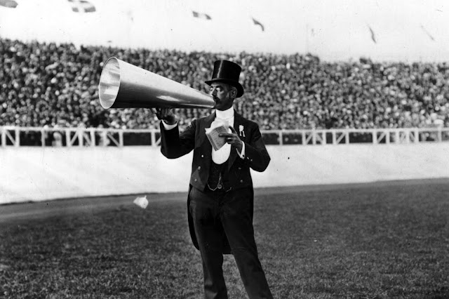 The City Toastmaster in top hat and tails, making announcements to the crowd with megaphone at the 1908 London Olympics. Your Russians are missing and other stories about past Olympics. marchmatron.com