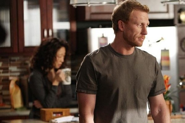 Grey's Anatomy - Owen stands in foreground, Yang in background
