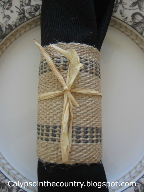 Black and White Fall Table -Using homemade napkin rings with raffia