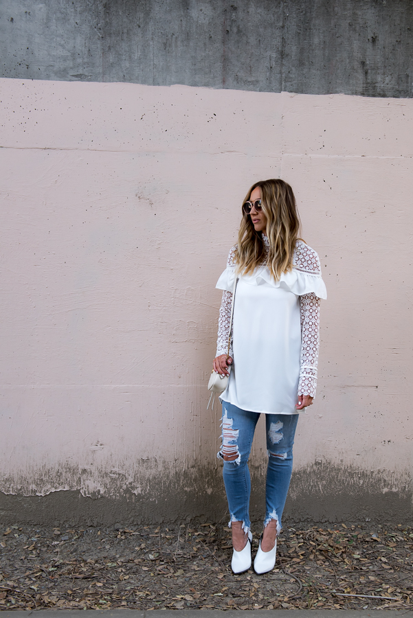 white ruffle and lace dress with ripped jeans parlor girl