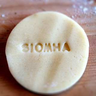 Síomha's name stamped in biscuit dough