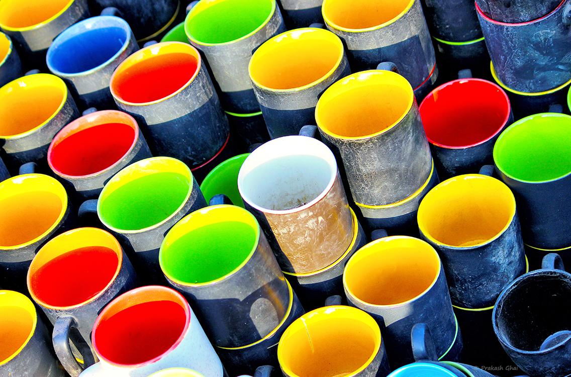A minimalist photo of Multicolored cups at an art exhibition in Jaipur