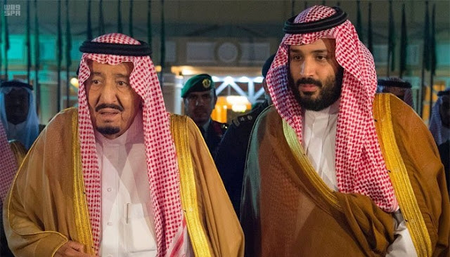 Saudi Arabia's King Salman bin Abdulaziz Al Saud walks with his son and Crown Prince Mohammed bin Salman, Riyadh, Saudi Arabia, November 8, 2017. Saudi Press Agency/Handout via REUTERS