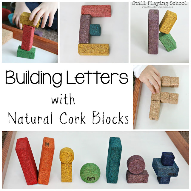 Kids build letters with KORXX cork building blocks
