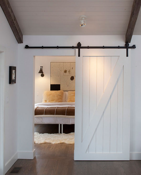 image result for white plank barn door to farmhouse country style bedroom