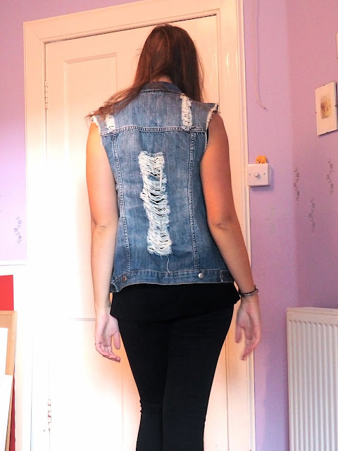 Rock 'n' Roll - outfit details - back of a ripped, over-sized denim waistcoat, with black skinny jeans