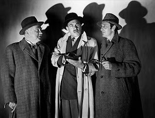 Basil Rathbone as Sherlock Holmes, Nigel Bruce as Dr Watson and Dennis Hoey as Lestrade