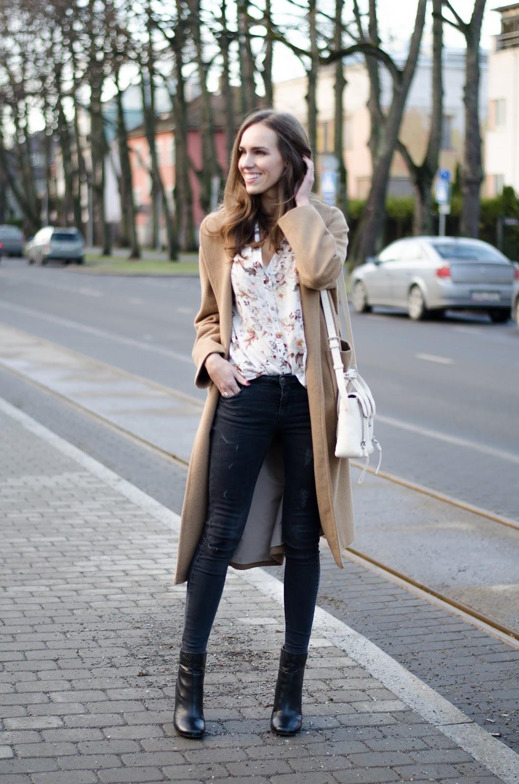 camel coat black jeans outfit