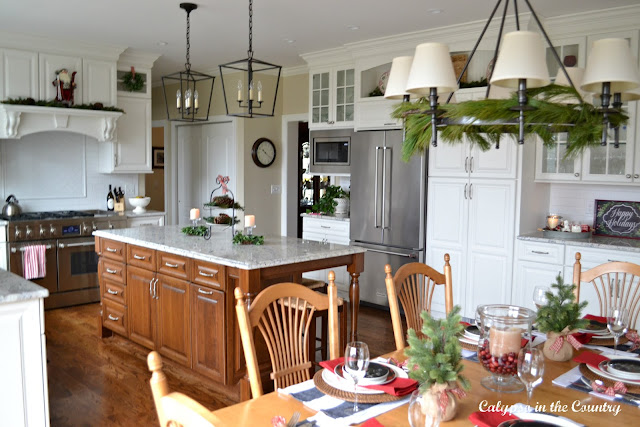 White Kitchen decorated with red, green and black for Christmas
