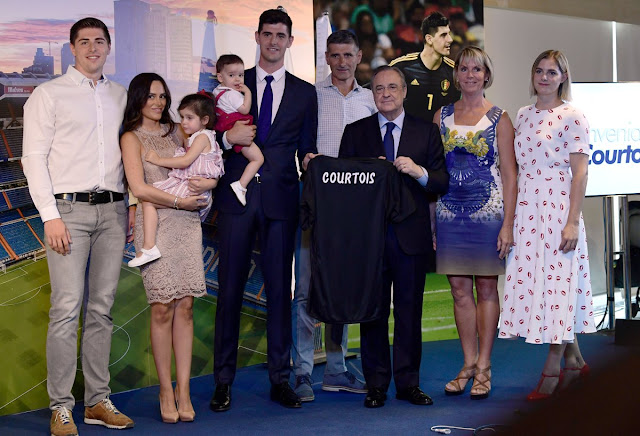 Thibaut Courtois pictured with his family and Florentino Perez at Real Madrid Unveiling