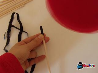 rivestire un bastoncino con nastro di raso