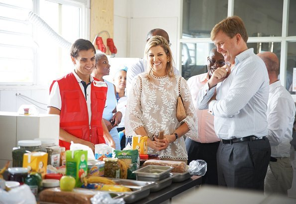 Queen Maxima Jewel wear Mango Floral Earrings, Zara guipure lace top and carried J. Crew Envelope clutch,