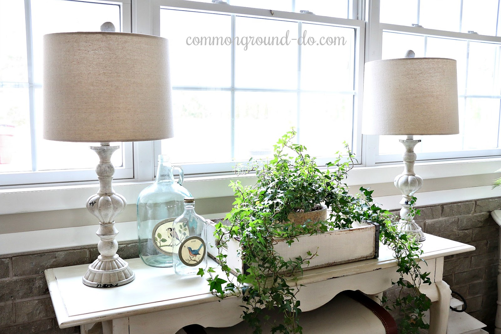 Common Ground Candlestick Lamps On The Sofa Table