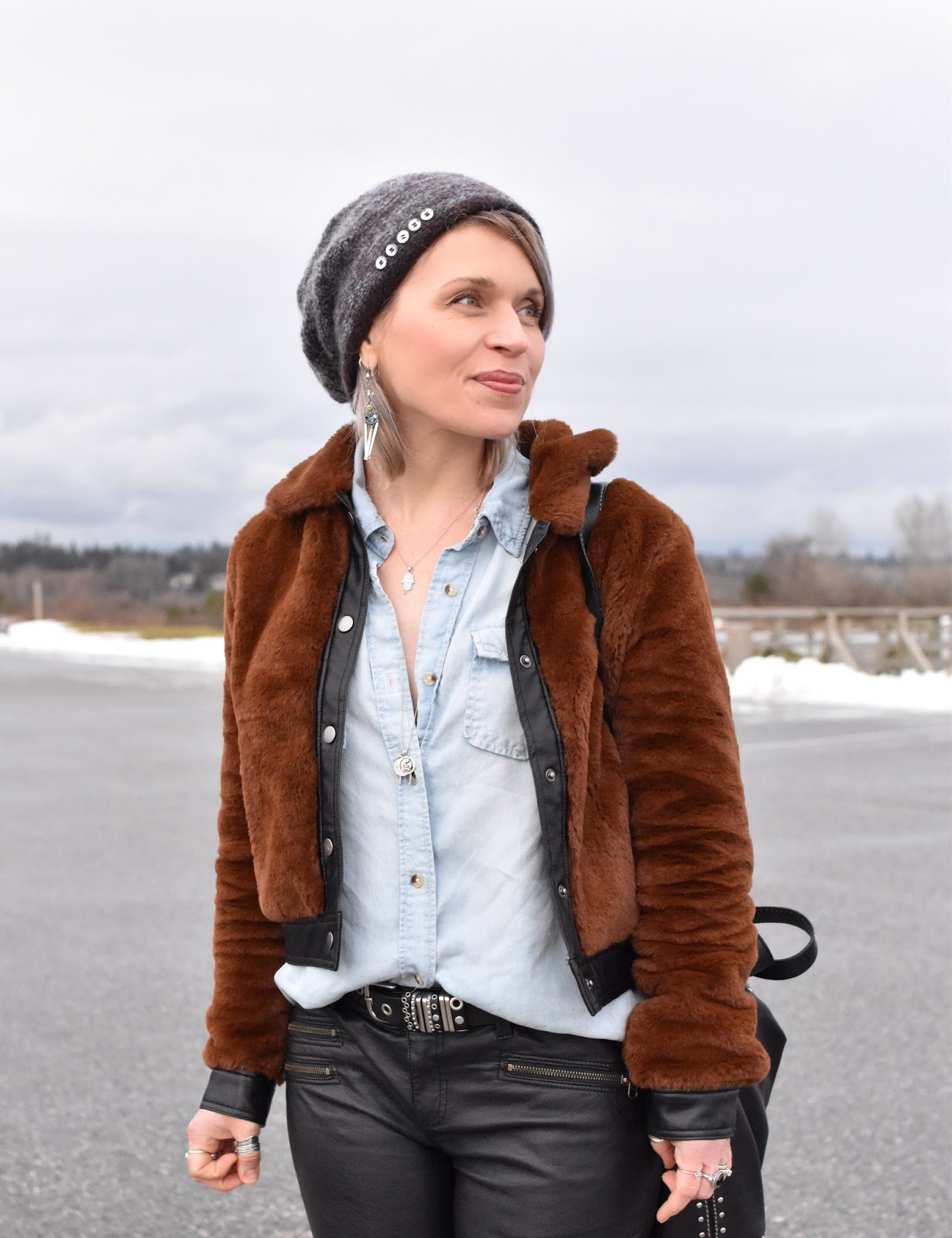 Monika Faulkner outfit inspiration - chambray shirt, vegan leather jeans, furry bomber, woolen beanie