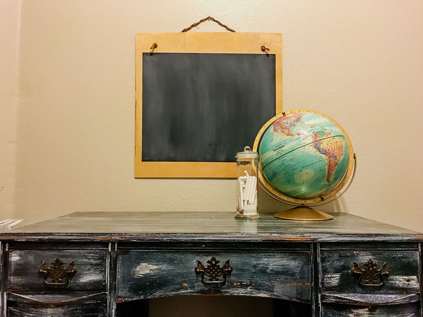 Easy DIY Chalkboard - Chalkboard with a Black Desk and Vintage Globe