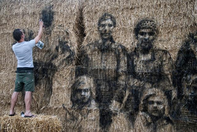 Street Art By Borondo On Straw. In Roma, Italy.