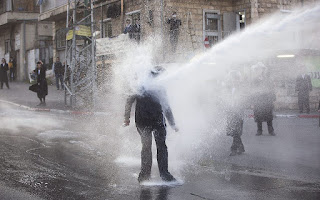 In this Wednesday, March 15, 2017 file photo, an ultra-Orthodox Jew gets hit by a police water canon during a protest against Israeli army conscription in Jerusalem. (AP/Oded Balilty)