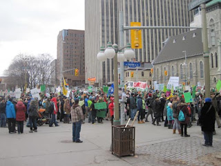 Crowds head past Confederation Park.