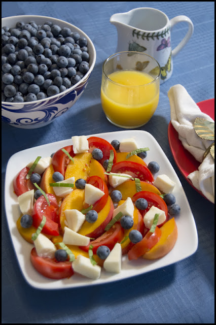 fresh peaches, blueberries, and tomatoes with fresh mozarella, basil, and a balsamic vinaigrette dressing.