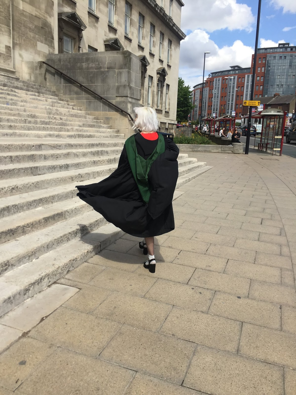 University of Leeds graduate in robes on Parkinson steps