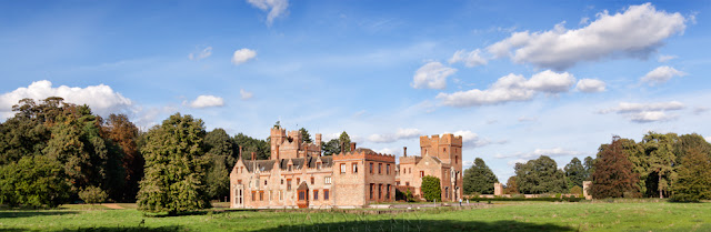 Oxburgh Hall in Norfolk on a sunny afternoon in a panoramic image