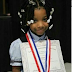 This 7 year old girl without hands won handwriting competition  (photos)