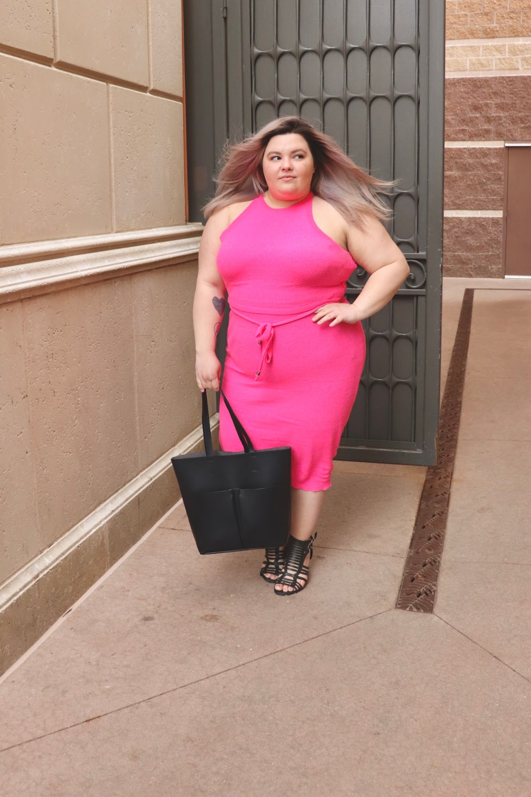 Chicago Plus Size Petite Fashion Blogger, YouTuber, and model Natalie Craig, of Natalie in the City, review's Fashion Nova's neon sweater dresses.