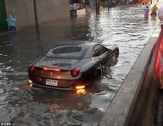 Photos: $800,000 Ferrari washed away by flood waters in Thailand