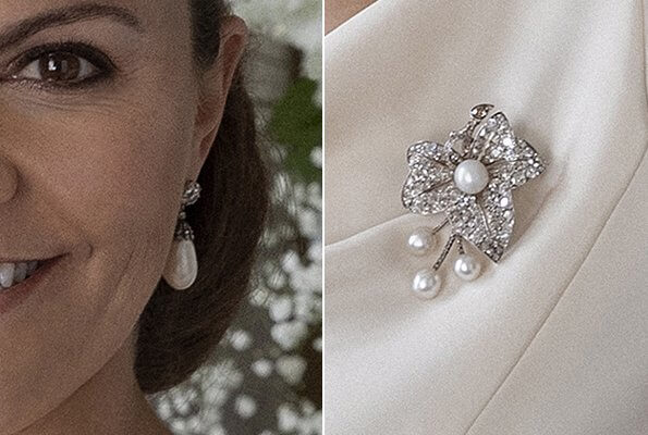 Crown Princess Victoria wore white drop pearl earrings, and pearl diamond brooch