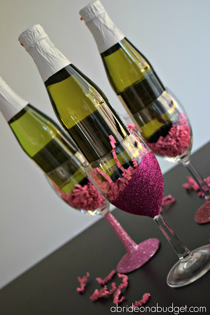 #ad Looking for a sparkling DIY? Check out these glitter wine glasses -- with an added sparkling juice -- from www.abrideonabudget.com. #dollartree