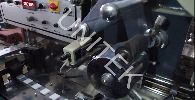 AUTOMATIC CASSETTE PACKING MACHINE